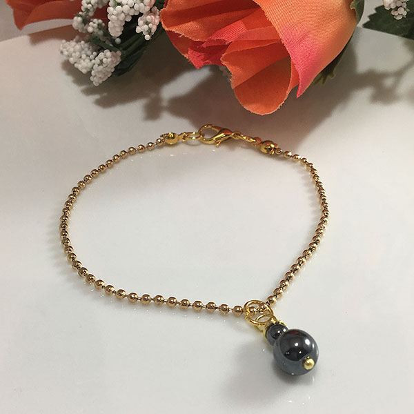 Gold Plated bracelet with Navy Blue Glass bead.