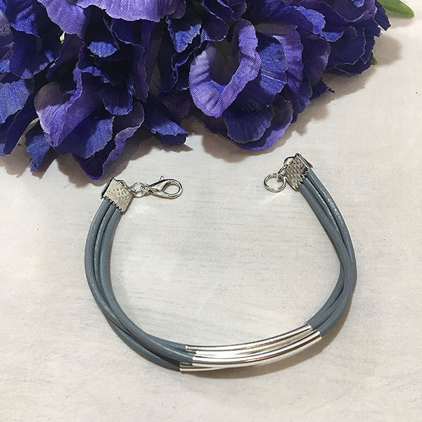 Multi strand grey Leather cord bracelet with silver metal tubes.