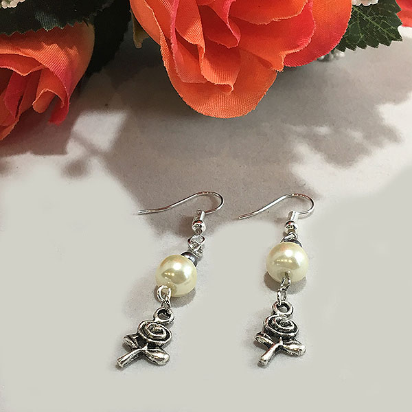 Silver plated earrings with Tibetan flower with ivory pearls