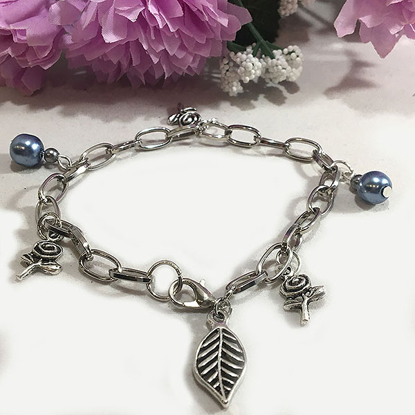 Silver plated bracelet with Tibetan flower and blue pearls