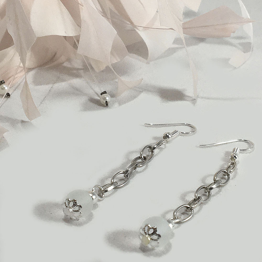 Silver plated earrings with frosted glass bead and a daisy